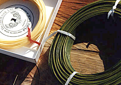 Two silk flylines, one in a box.